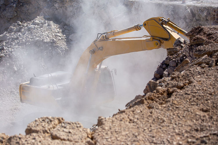 Crawler excavator, working to transport rocks at coal mines Activity Backhoe BIG Bucket Building Bulldozer Construction Dig Digging Earth Earthmover Earthwork Engineering Equipment Excavating Excavation Excavator Field Heavy Huge Hydraulic Industrial Industry Landscape Loader Loading Machine Machinery Mechanical Metal Mine Mineral Mining Mountain Mover Outdoors Roadwork Rock Sand Scoop Shovel Site Soil Stone Technology Tractor Truck Vehicle Work Yellow