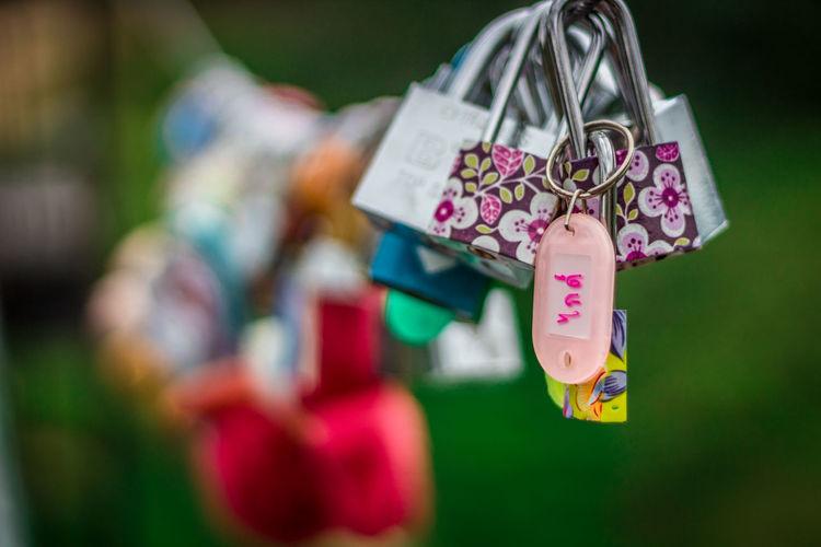 Close-up of love padlocks hanging outdoors