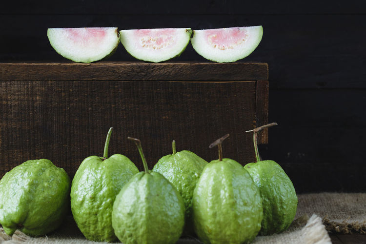Close-up of guavas with burlap on table