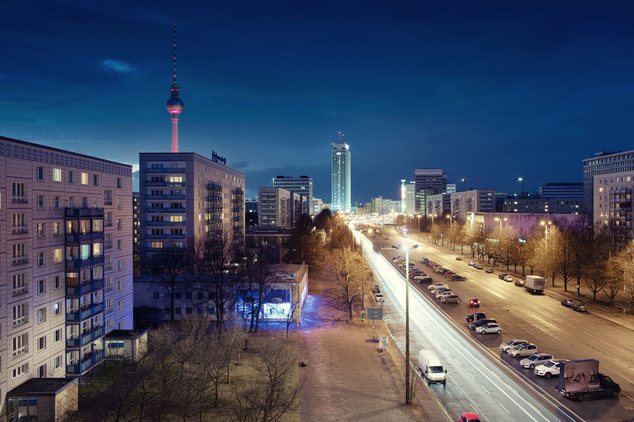 Architecture Beleuchtung Berlin Building Exterior Built Structure City City Life Fernsehturm Illuminated Karl Marx Allee Light Trail Long Exposure Modern Motion Night No People Outdoors Road Sky Skyscraper Strasse Bei Nacht Street Tower Transportation Travel Destinations