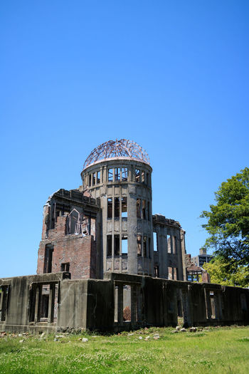 Atomic Bomb Dome, Hiroshima-shi, Japan. A-Bomb Dome Atomic Bomb Dome Hiroshima Atomic Bomb Dome Hiroshima Peace Memorial Park Hiroshima-shi Japan Japanese  Japanese History Ruins World War 2 Architecture Building Exterior Built Structure Clear Sky Day Dome Hiroshima Historic History No People Nuclear Bomb Outdoors Rural Scene Sky War