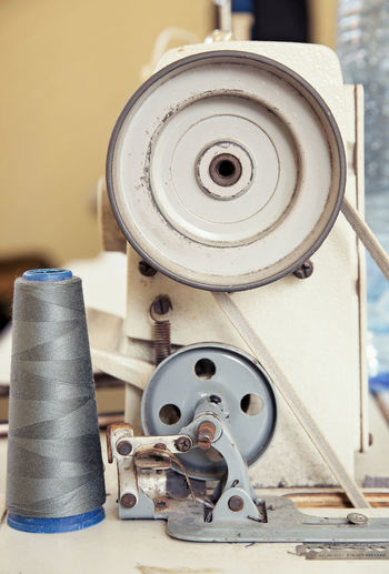 Metal Indoors  Thread No People Still Life Close-up Spool Equipment Sewing Item Focus On Foreground Industry Machinery Table Work Tool Large Group Of Objects Textile Industry Rolled Up Retro Styled Circle Electrical Equipment Entrepreneur