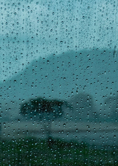 Rain at the window Rain At The Window Rain Falls Rain Falls To The Mirror Architecture Backgrounds Built Structure Close-up Day Drop Full Frame Glass - Material Indoors  Nature No People Rain RainDrop Rainy Season Sky Water Weather Wet Window