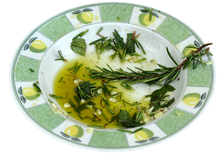 Garlic and herb infused olive oil Barbecue Care Cooking Cuisine Essential Flavor Food Garlic Gourmet Green Herb Herbal Ingredients Marinade Medical Medicinal Nutrition Olive Oil Plate Remedy Rosemary Sage Sauce Spicy Tasty