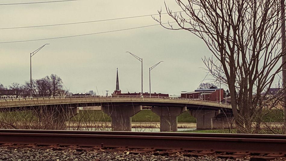 Bridge Bridge Over Water Buildings Buildings & Sky Light Poles Ohio, USA Power Lines Railroad Ties Railroad Track Railroad Tracks Retro River Rocks Steeple Trees USA water