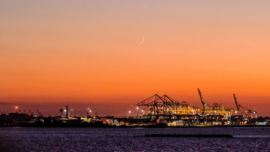 HUAWEI Photo Award: After Dark Architecture Beauty In Nature Business Commercial Dock Crane - Construction Machinery Freight Transportation Harbor Illuminated Industry Machinery Nature Night No People Outdoors Pier Sea Shipping  Sky Transportation Water