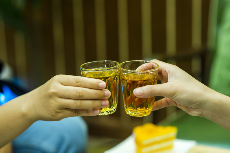 Alcohol Celebration Celebratory Toast Drink Drinking Glass Finger Focus On Foreground Food And Drink Friendship Glass Hand Holding Human Body Part Human Hand Leisure Activity Lifestyles People Real People Refreshment Togetherness Women