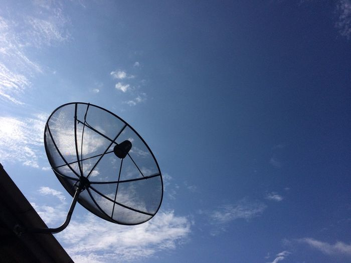 satellite disk on roof Satellite Dish Satellite Dish Aerial Communication Telecommunications Equipment Antenna - Aerial Technology Sky Blue Connection Global Communications Broadcasting Roof Home House Bluesky Blue Sky Day