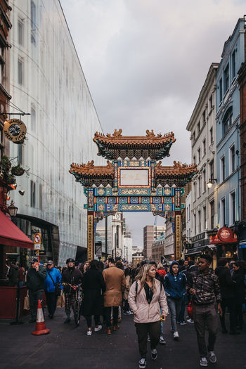 London Uk Europe Travel Tourism Real People Chinatown Soho Chinese Culture Area People Gate Entrance Culture Group Of People Built Structure Architecture Building Exterior Crowd City Large Group Of People Lifestyles Street City Life Walking Outdoors Leisure Activity