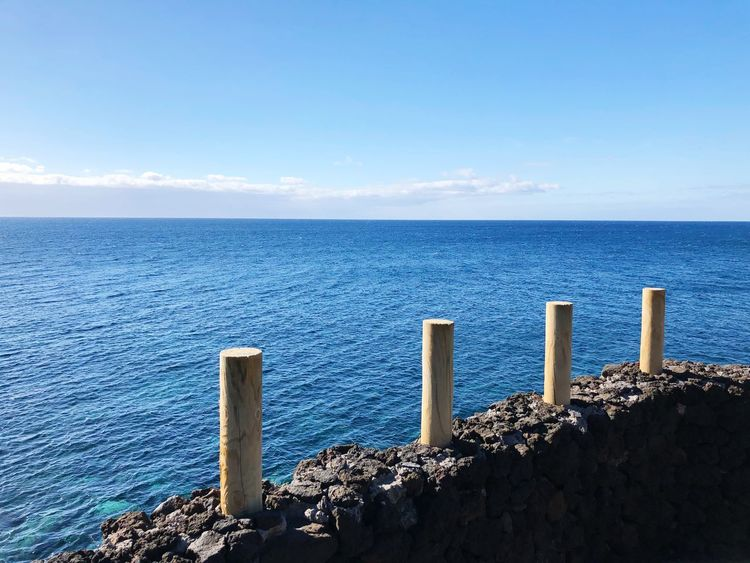 Water Sea Sky Horizon Horizon Over Water Scenics - Nature Beauty In Nature Tranquil Scene Tranquility Nature Sunlight Beach Outdoors Wooden Post Day Non-urban Scene Idyllic Blue Post No People
