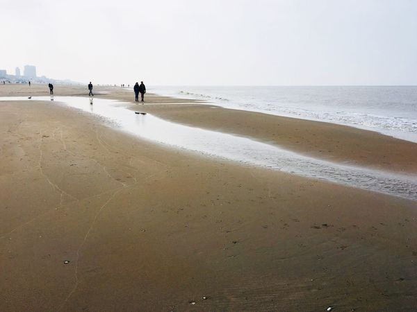 Walk at the beach Cloudy Day Low Tide Beach Sea Sand Walking Horizon Over Water Beauty In Nature Real People Sky Tranquil Scene