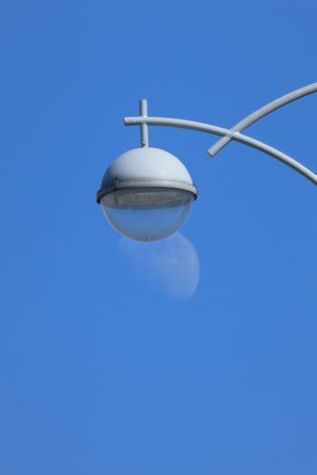 Blue Sky Clear Sky Low Angle View No People Copy Space Lighting Equipment Nature Sphere Day Outdoors Technology Connection Street Light Sunlight Street Electrical Equipment Moon Day Moon The Minimalist - 2019 EyeEm Awards