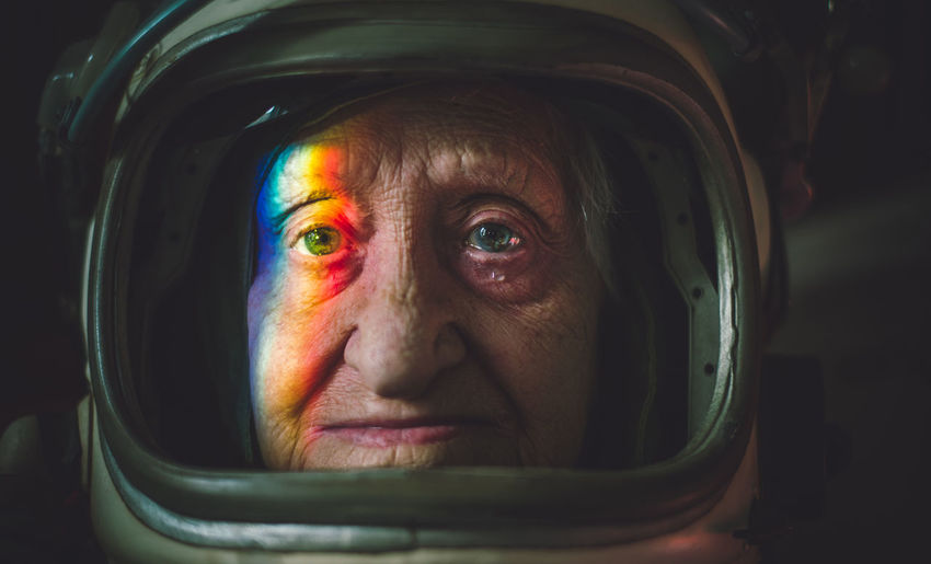 Close-up portrait senior woman wearing space suit
