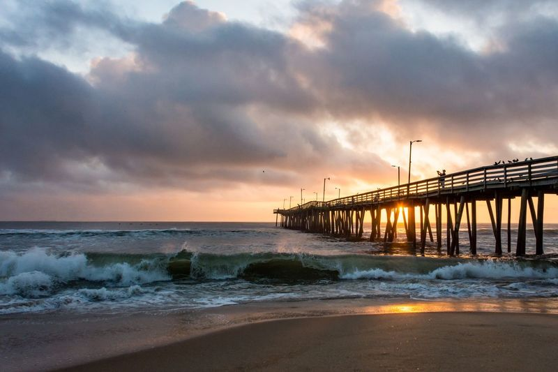 Virginia Beach Sunrise EyeEm Selects Clouds And Sky Clouds Sun East Coast Outdoors Serene Solitude Beach Virginia Beach Sand Sunrise Shore Ocean Waves Wooden Beauty In Nature Scenics - Nature Nature Horizon No People Sand Horizon Over Water Outdoors Tranquility Pier Built Structure