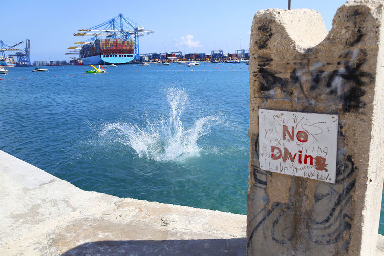 No diving? Sorry Forbidden Harbor Malta Annamour Beach Built Structure Day Dresskot Nodiving Outdoors Sea Water Summer In The City