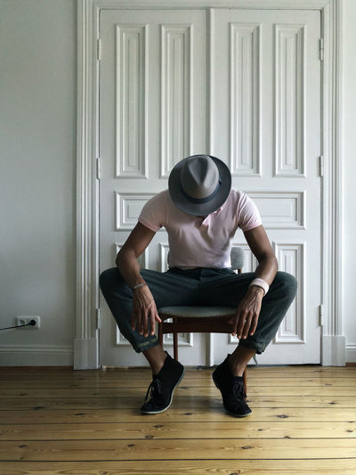 Lifestyle Portrait Of A Man  Man Wooden Floor Looking Down Sitting Alone Fashion Pink Hat Selfie ✌ Self Portrait Portrait Adult Adults Only Chair Day Front View Full Length Indoors  One Person People Real People Sitting Young Adult Young Women Love Yourself This Is Masculinity Visual Creativity This Is My Skin The Fashion Photographer - 2018 EyeEm Awards The Still Life Photographer - 2018 EyeEm Awards The Portraitist - 2018 EyeEm Awards The Portraitist - 2018 EyeEm Awards The Fashion Photographer - 2018 EyeEm Awards Redefining Menswear
