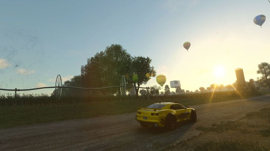 Dramatic Angles Car Mode Of Transport Sunlight Shadow Tree Outdoors Sky Green Color Lens Flare Sunbeam No People Racing Mordern Muscle Gameplay THE CREW Hotair Balloons TakeoverContrast Photographing Performances Screenshot Speedmaster Gamerforver Sunny Gaming Illuminated Connected By Travel