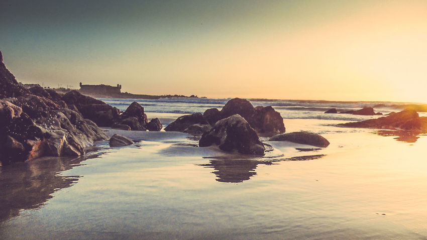 Beach Beauty In Nature Clear Sky Day Horizon Over Water Nature No People Outdoors Pebble Beach Rock - Object Scenics Sea Sky Sunset Tranquil Scene Tranquility Water Wave