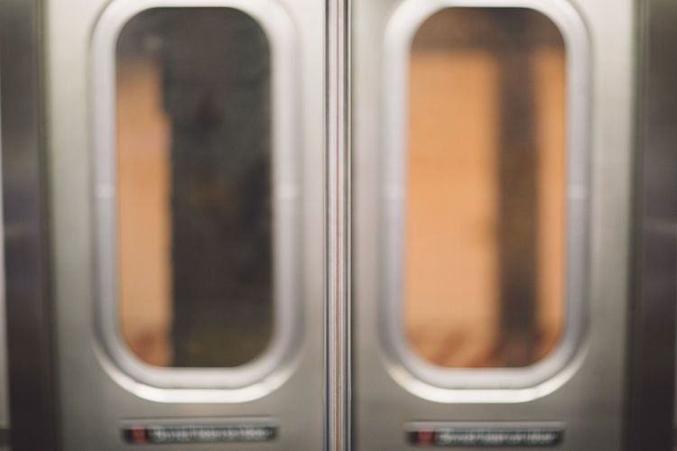 Close-up of glass doors in train