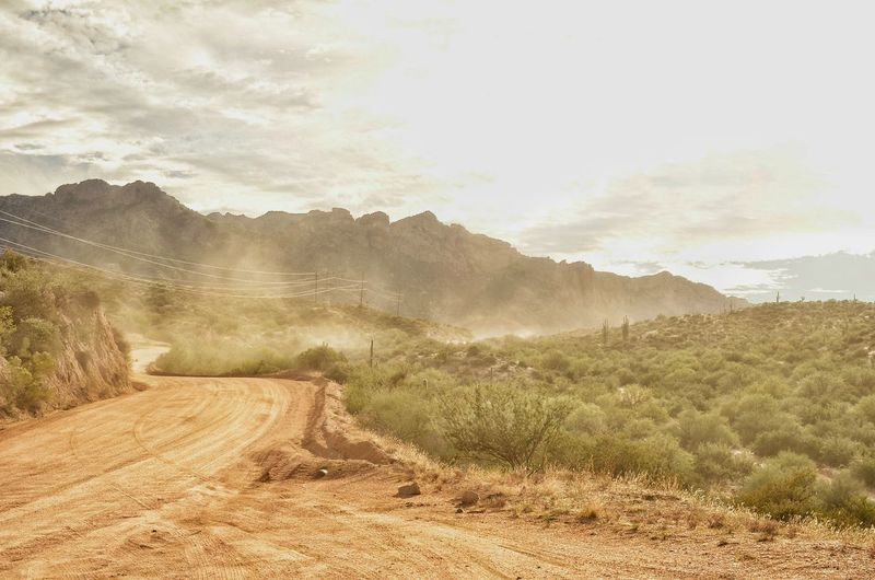 Dirt road against mountains