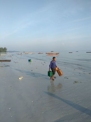 Beach Sea Water People Full Length One Person Day Horizon Over Water Outdoors Sky Occupation Adult Fisherman Men Nature One Man Only Low Tide Only Men Beauty In Nature Adults Only EyeEmNewHere Sea Life Beach Life Beach View Tradisional Fish Chatcher