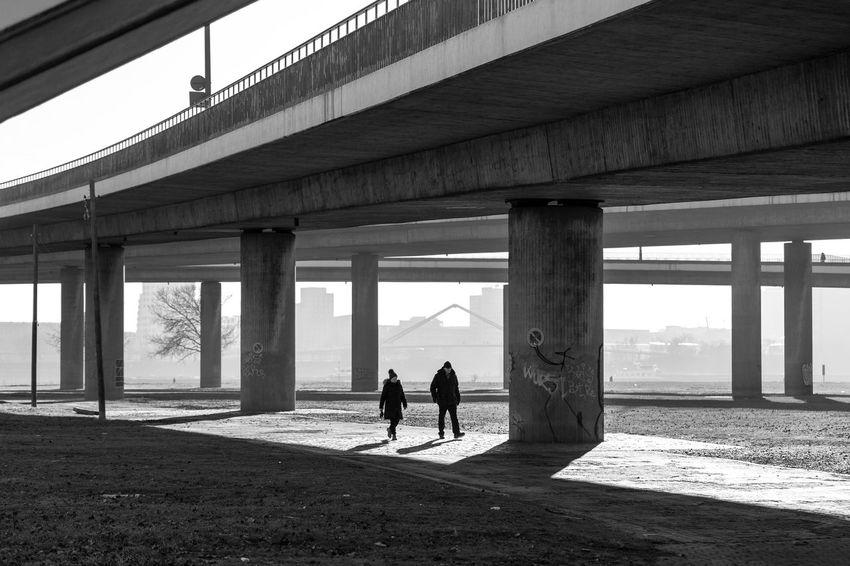Düsseldorf, Germany Architecture Below Blackandwhite Bnw Bridge Bridge - Man Made Structure Building Exterior Built Structure City Day Deutschland Düsseldorf Germany NRW Outdoors Real People Rhein Rheinkniebrücke Rheinwiesen Schwarzweiß Two People Under The Bridge