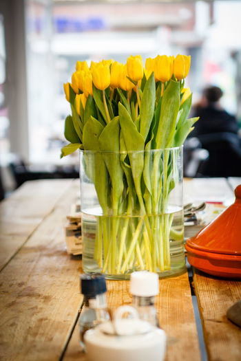 Yellow tulips in vase on table