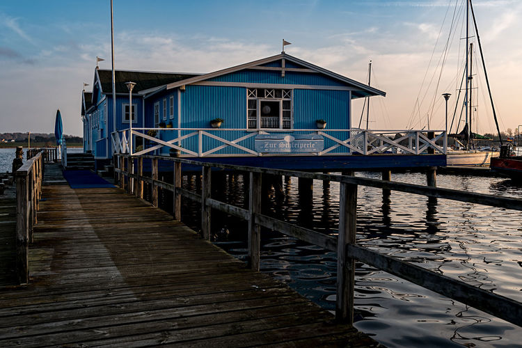 BlueHouse Schlei Schleswig-Holstein Architecture Arnis Beauty In Nature Building Exterior Built Structure Cloud - Sky Day Harbor Jetty Moored Nature No People North Germany Outdoors Pier Sea Sky Tranquility Transportation Travel Destinations Water Wood - Material Wood Paneling
