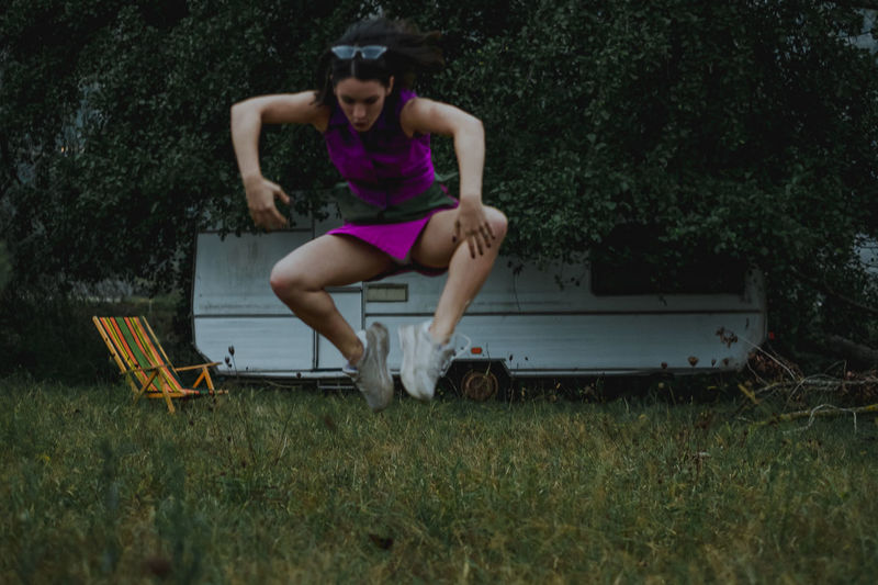 Woman Jumping Over Field