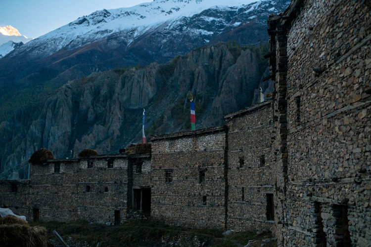 View Of Buildings Against Snowcapped Mountain