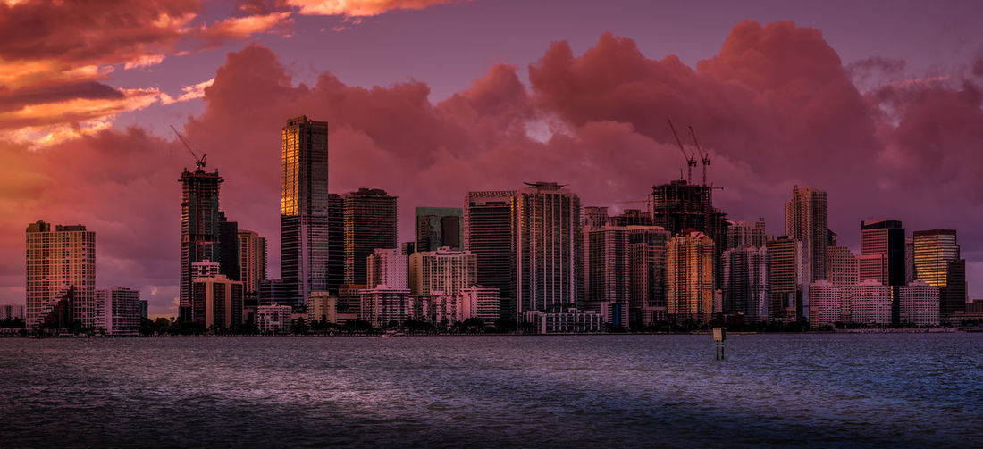 The Magenta City Architecture Biscayne Bay City Cityscape Downtown District Miami Modern Outdoors Sky Sunset Travel Destinations Urban Skyline Water