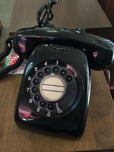 High Angle View Of Rotary Phone On Table
