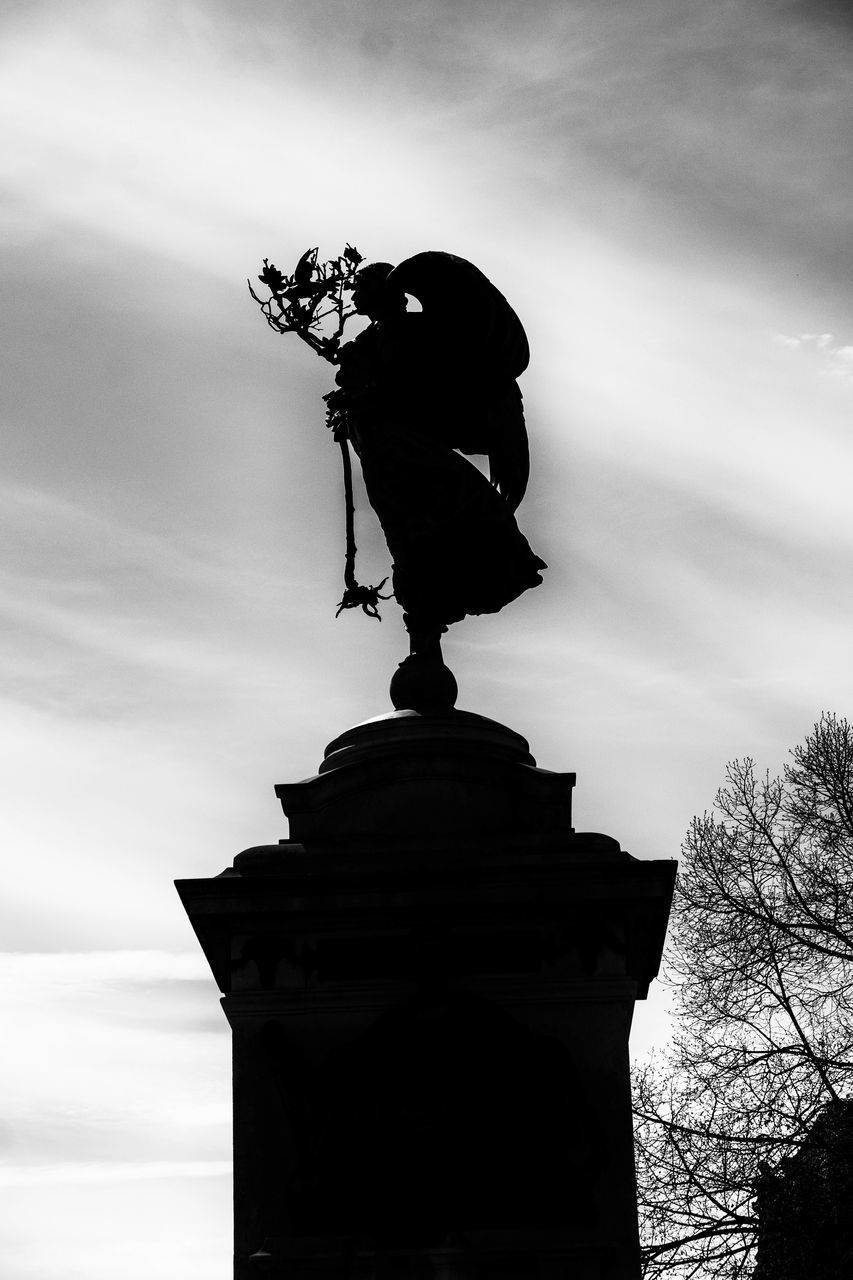 statue, sculpture, human representation, art and craft, male likeness, craft, cloud - sky, low angle view, sky, outdoors, architecture, monument, history, silhouette, built structure, day, travel destinations, memorial, no people, building exterior