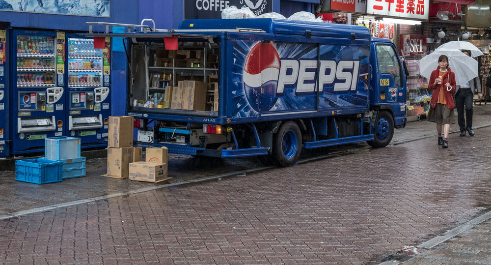 Pepsi delivery truck stopping in the street of Shibuya, Tokyo during a rainy day. Blue Blue Truck Company Delivery Editor Japan Lorry Pepsi Rain Rainy Day Retail  Shibuya Sidewalk Soft Drink Tokyo Transportation Truck Wet