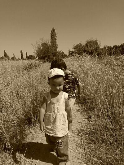 Boy standing on field