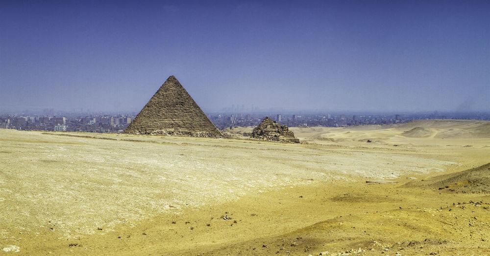 Pyramid on desert against clear sky
