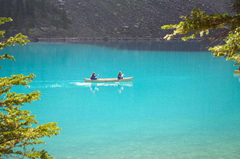 View Of People In Canoe On Lake