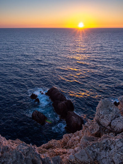 Sunset on Cape Lefkakda Outdoors Water Nature Sea Greece Ionian Sea Ionian Islands Lefkada Island Greek Islands Sunset Rock Rocky Coastline Scenics - Nature Sun Idyllic