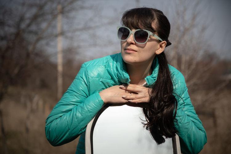Portrait of teenage girl wearing sunglasses standing outdoors