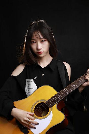 Plucking An Instrument Black Background Guitar Musician Musical Instrument Portrait Beautiful Woman Young Women Music Beauty