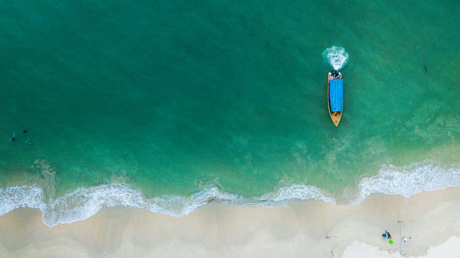 Drone Shot Of Motorboat On Shore At Beach