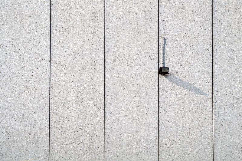 Halogen light on concrete wall