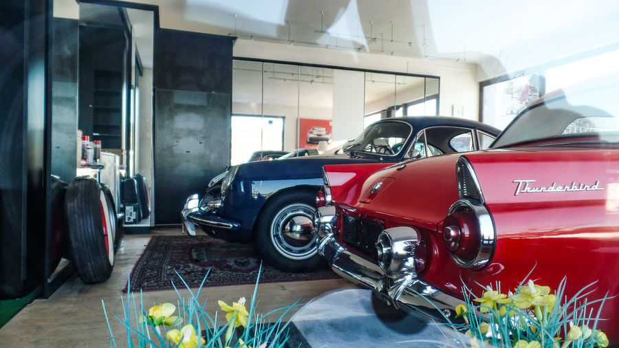 Mode Of Transportation Car Motor Vehicle Transportation Land Vehicle Day Architecture Indoors  Shopping Auto Repair Shop Automobile Industry Built Structure No People Red Stationary City Tire Wheel Luxury Garage
