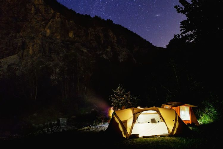 Close-up of tent against mountain at night
