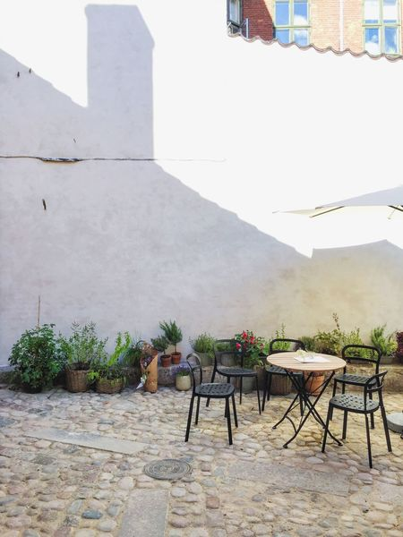Backyardphotography Backyard Composition Outdoor Furniture Exterior View Exterior Outdoor Photography Shadows Shadows On The Wall Exterior Design Outdoors Still Life Group Of Objects Objects Garden Garden Photography Gardens Cobblestones Cobblestone Cobble Stone Cobblestone Streets Hidden Gems