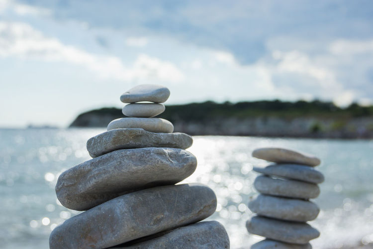 pebble stone towers by the sea, Zen, peace Stack Stone - Object Pebble Balance Zen-like Solid Rock Focus On Foreground Stone Nature Water Rock - Object Sky Beach No People Tranquility Land Day Cloud - Sky Outdoors