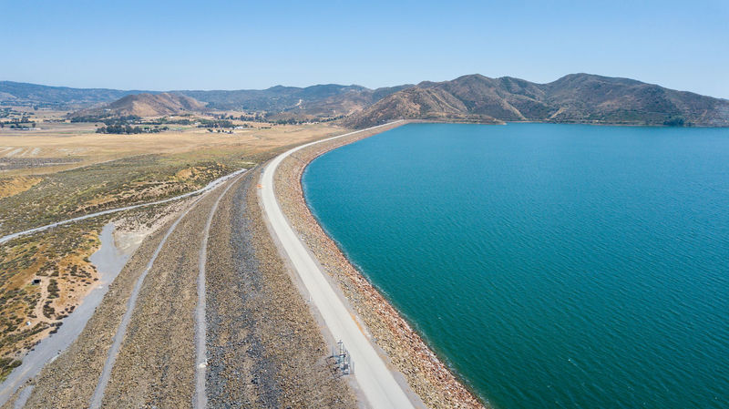 Diamond Valley Lake, East Dam Blue Water California Clear Water Dam Destinations Diamond Valley Lake Drone  Dronephotography Droneshot Drought Hemet CA Hills Lake Manmade Mavic Mavic Pro No People Outdoors Pathway Reservoir Scenics Southern California Sunny Travel Destinations Water
