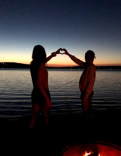 Sunset love Water Two People Sky Sunset Nature Women Adult Real People Leisure Activity People Silhouette Friendship Couple - Relationship Three Quarter Length Sitting Togetherness Lifestyles Bonding Sea Outdoors