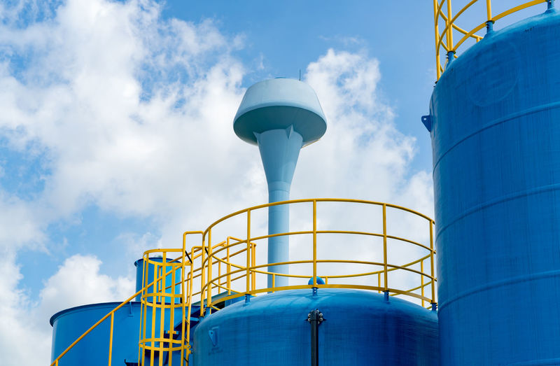Closeup fuel storage tank in petroleum refinery. blue big tank of oil storage. fuel silo.