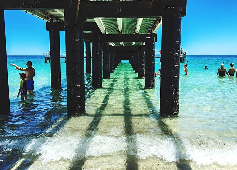 Clear Waters: Under the Jetty Summer Australia Beach Photography Beach Western Australia Jetty Under Jetty Jetty Shadows Shadows Indian Ocean Ocean Sea Turquoise Water Travel Jetty Area Families Sand Waves Clear Ocean Blue Ocean Blue Seascape Coogee Beach Beach Life Summertime